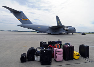 Luggage at airfield waiting to be transported to the airplane