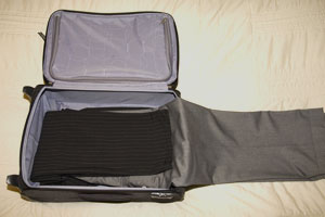 Trousers being folded into suitcase
